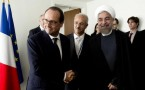 Iran's President Hassan Rouhani (R) and his French counterpart Francois Hollande