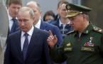 Russian President Vladimir Putin (L)