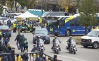 View of police escorts riding motorcyles wearing Michigan helmets