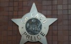 A Chicago police badge in front the Chicago Public Safety Headquarters
