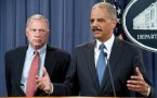 US Attorney General Eric Holder (R), wit