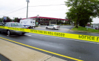 A Richmond, Va., Exxon station is sealed off by police