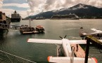 Sea planes, small boats, and huge cruise ships in harbor of Juneau