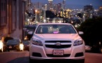 Lyft At Its San Francisco Headquarters Showcasing Lyft Cars, The Glowstache, The Lyft App, Lyft Passengers And Drivers