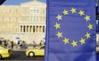 A European flag is pictured with the Greek Parliament in the...