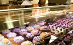 Cupcakes sit on display inside the bakery of a new Whole Foods Market