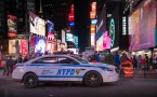 NYPD police car in New York Times Square night scenes
