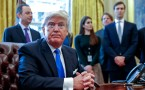 President Donald Trump looks on after signing one of five executive orders related to the oil pipeline industry in the Oval Office of the White House January 24, 2017 in Washington, DC