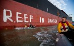 Greenpeace activists paint 'Reef in Danger' in Gladstone, Australia
