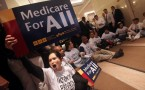 Protesters for the health care reform sit inside the lobby of Aetna head office in New York City in 2009.