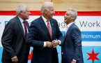 U.S. Vice President Joe Biden (C) shares a laugh with Chicago Mayor Rahm Emanuel (R) and Illinois Governor Pat Quinn