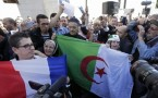 Muslims, holding French and Algerian flags in Paris