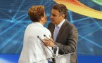 Aecio Neves (R) greets Dilma Rousseff