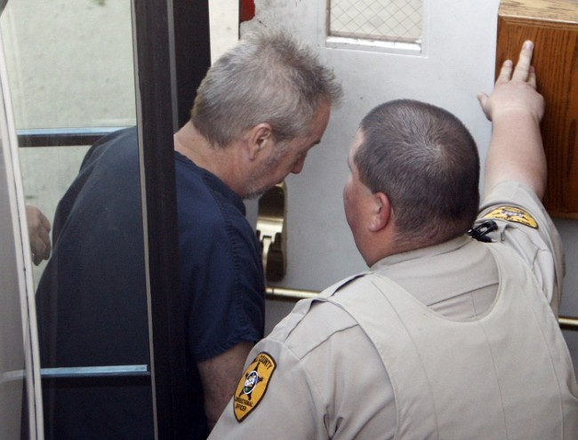 Drew Peterson leaves his arraignment at the Will County Courthouse in Joliet