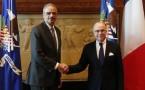Eric Holder (L) with French Interior Minister Bernard Cazeneuve